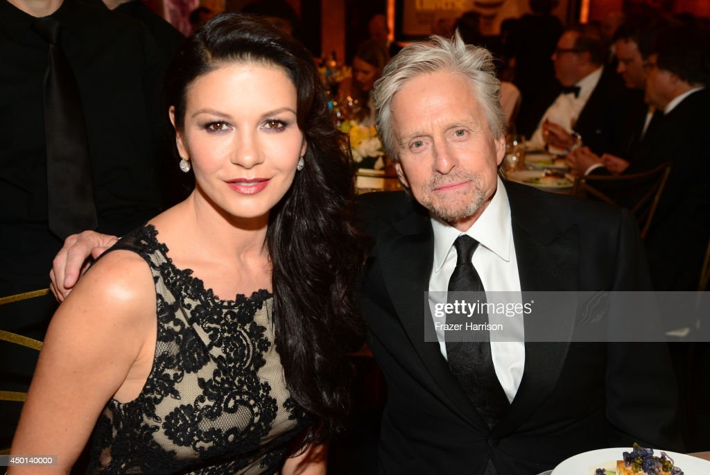 Actors Catherine Zeta-Jones (L) and <a gi-track='captionPersonalityLinkClicked' href=/galleries/search?phrase=Michael+Douglas&family=editorial&specificpeople=171111 ng-click='$event.stopPropagation()'>Michael Douglas</a> attend the 2014 AFI Life Achievement Award: A Tribute to Jane Fonda at the Dolby Theatre on June 5, 2014 in Hollywood, California. Tribute show airing Saturday, June 14, 2014 at 9pm ET/PT on TNT.