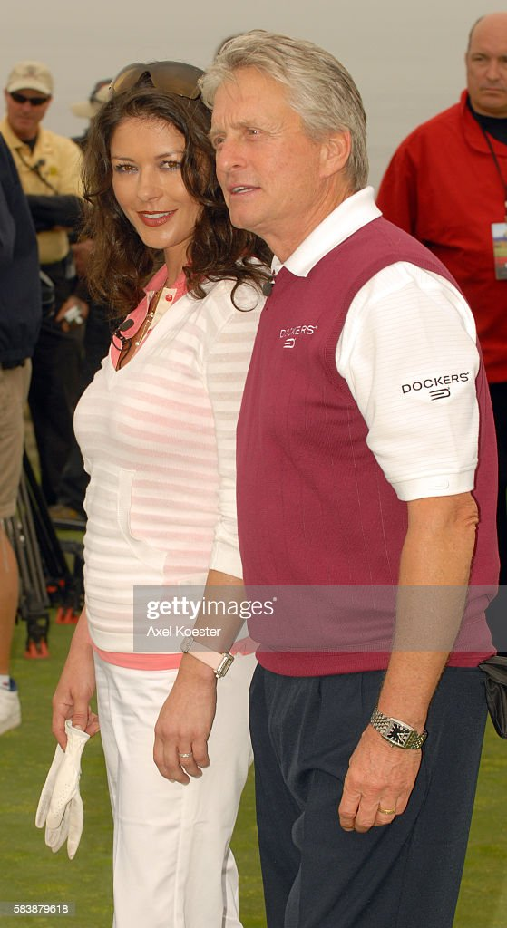 Actors Catherine ZetaJones and Michael Douglas play in the Ninth Annual Michael Douglas Friends Celebrity Golf Tournament at the Trump National Golf...