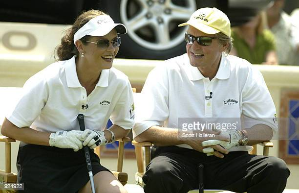 Actors Catherine ZetaJones and Michael Douglas share a laugh during the 4th Annual Michael Douglas Friends Celebrity Golf presented by Lexus to...