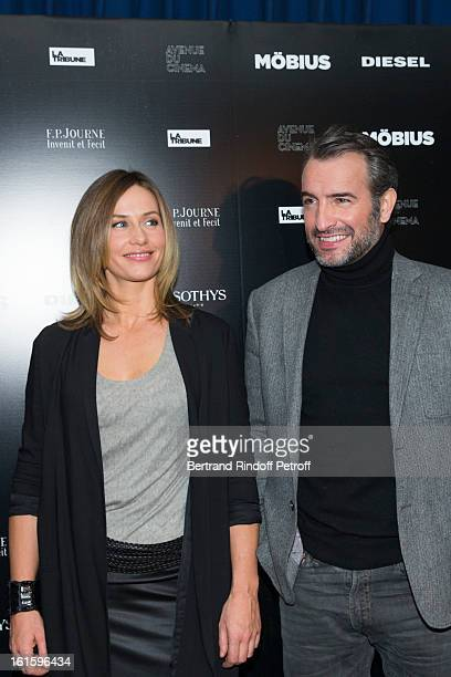 Actors Cecile de France and Jean Dujardin pose during a photocall for Mobius premiere as part of 'Avenue des Champs Elysees Avenue du Cinema...