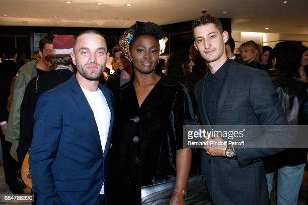 Actors Cedric Kahn Aissa Maiga and Pierre Niney attend the Montblanc ChampsElysees Flagship Reopening on May 18 2017 in Paris France