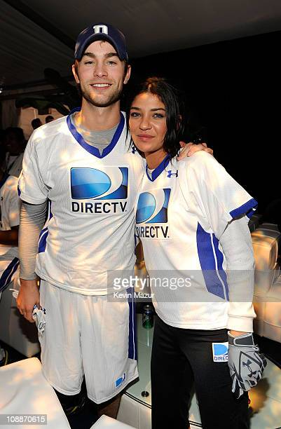 Actors Chace Crawford and Jessica Szohr during DIRECTV's Fifth Annual Celebrity Beach Bowl at Victory Park on February 5 2011 in Dallas Texas