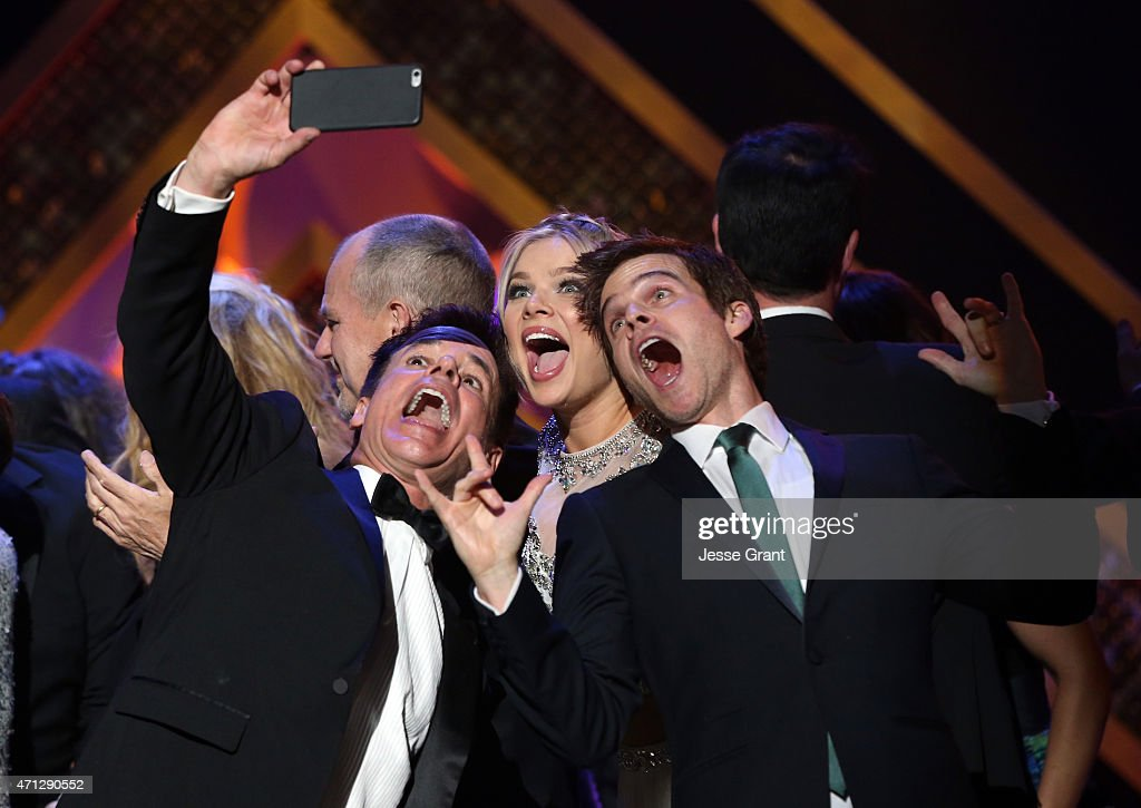 Actors Chad Duell Kelli Goss and Greg Rikaart take a selfie onstage during The 42nd Annual Daytime Emmy Awards at Warner Bros Studios on April 26...