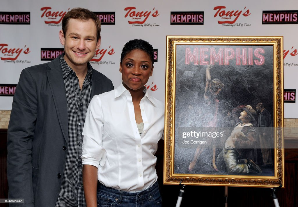Actors Chad Kimball (L) and Montego Glover attend the 'Memphis' cast portrait unveiling at Tony's di Napoli on September 23, 2010 in New York City.