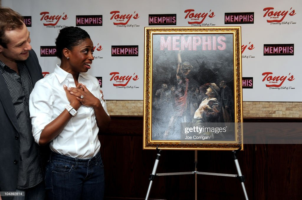 Actors Chad Kimball and Montego Glover attends the 'Memphis' cast portrait unveiling at Tony's di Napoli on September 23, 2010 in New York City.