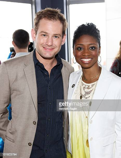 Actors Chad Kimball and Montego Glover pose as Tony Award nominees visit The Empire State Building on June 9 2010 in New York City