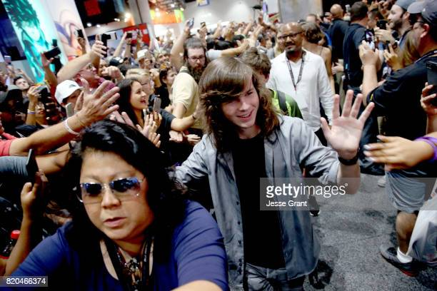 Actors Chandler Riggs and Seth Gilliam from 'The Walking Dead' sign autographs and take photos with fans at San Diego ComicCon International 2017 at...