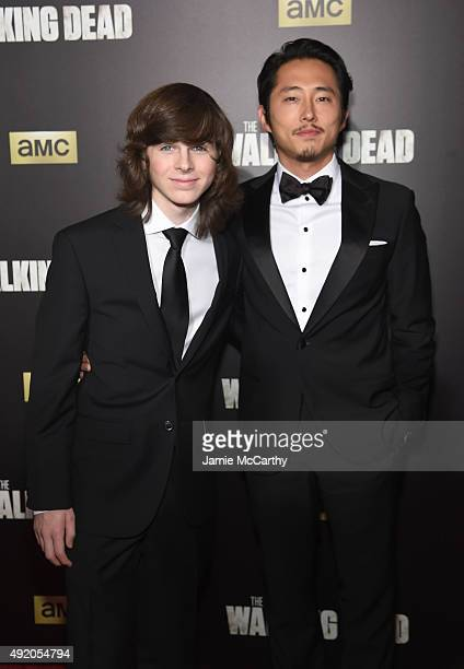 Actors Chandler Riggs and Steven Yeun attend AMC's 'The Walking Dead' Season 6 Fan Premiere Event 2015 at Madison Square Garden on October 9 2015 in...