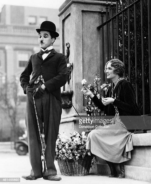 Actors Charlie Chaplin as The Tramp and Virginia Cherrill as a blind flower seller in the film 'City Lights' /Getty Images