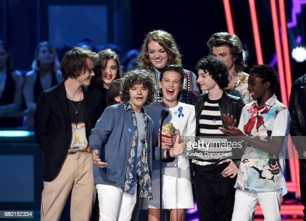Actors Charlie Heaton Natalia Dyer Gaten Matarazzo Shannon Purser Millie Bobby Brown Finn Wolfhard Joe Keery and Caleb McLaughlin accept the award...