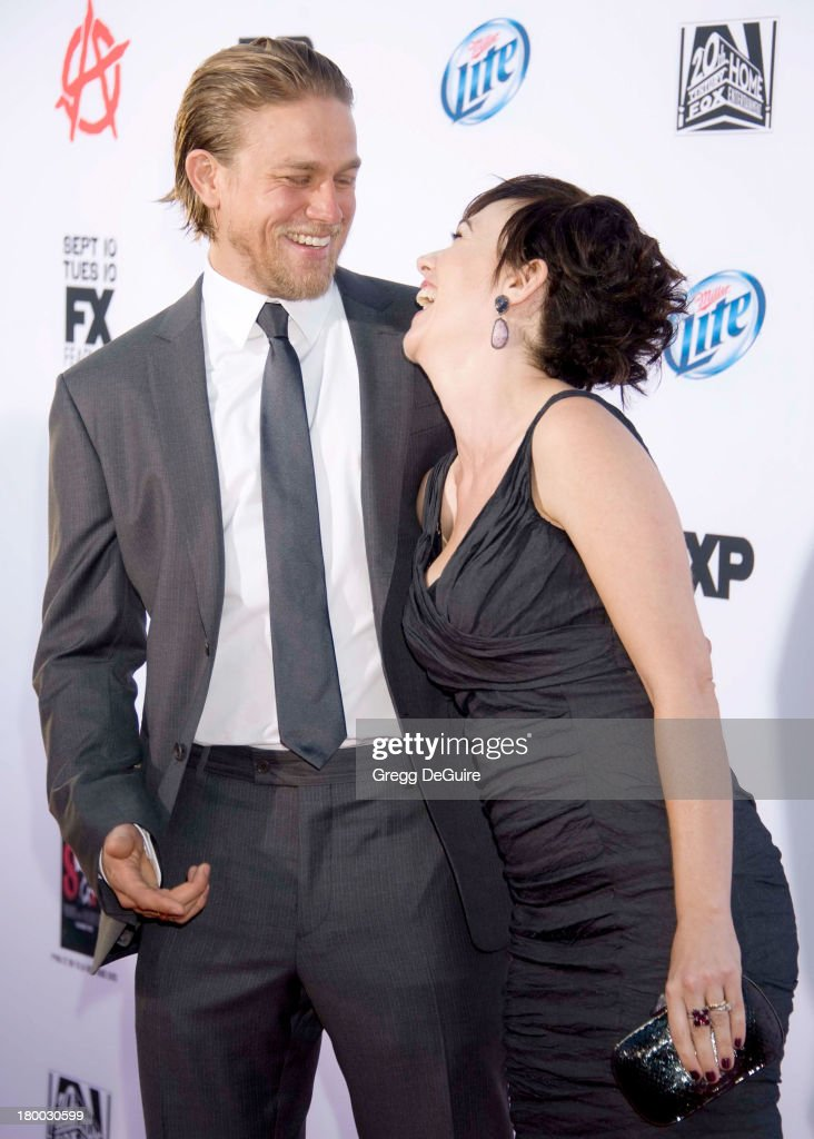 Actors <a gi-track='captionPersonalityLinkClicked' href=/galleries/search?phrase=Charlie+Hunnam&family=editorial&specificpeople=223913 ng-click='$event.stopPropagation()'>Charlie Hunnam</a> and <a gi-track='captionPersonalityLinkClicked' href=/galleries/search?phrase=Maggie+Siff&family=editorial&specificpeople=4407086 ng-click='$event.stopPropagation()'>Maggie Siff</a> arrive at FX's 'Sons Of Anarchy' Season 6 premiere screening at Dolby Theatre on September 7, 2013 in Hollywood, California.