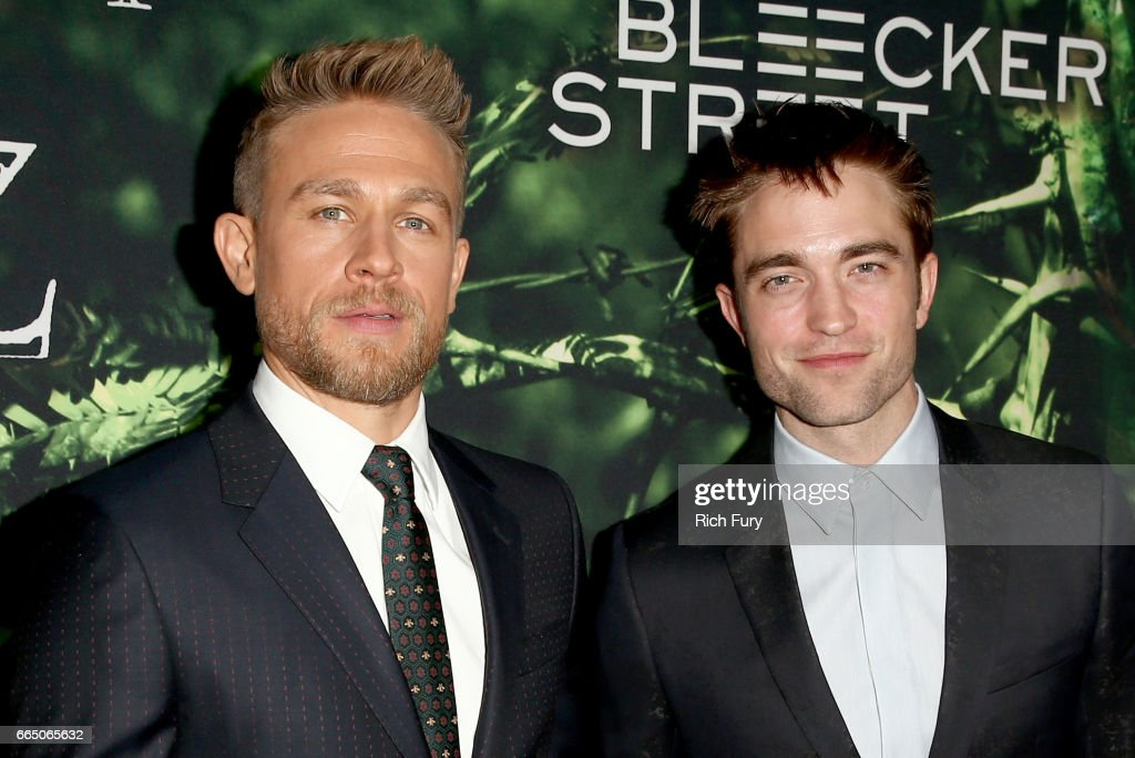 Actors Charlie Hunnam (L) and Robert Pattinson attend the premiere of Amazon Studios' 'The Lost City Of Z' at ArcLight Hollywood on April 5, 2017 in Hollywood, California.