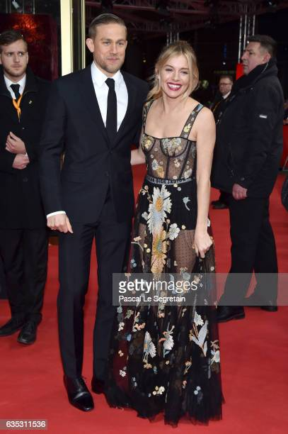 Actors Charlie Hunnam wearing Prada and Sienna Miller wearing Dior attend the 'The Lost City of Z' premiere during the 67th Berlinale International...