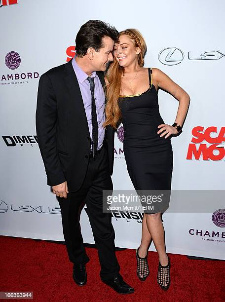Actors Charlie Sheen and Lindsay Lohan arrive at the Dimension Films' 'Scary Movie 5' premiere at the ArcLight Cinemas Cinerama Dome on April 11 2013...