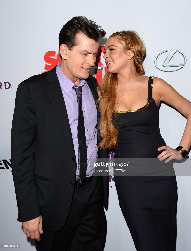 Actors <a gi-track='captionPersonalityLinkClicked' href=/galleries/search?phrase=Charlie+Sheen&family=editorial&specificpeople=206152 ng-click='$event.stopPropagation()'>Charlie Sheen</a> (L) and <a gi-track='captionPersonalityLinkClicked' href=/galleries/search?phrase=Lindsay+Lohan&family=editorial&specificpeople=171623 ng-click='$event.stopPropagation()'>Lindsay Lohan</a> arrive at the Dimension Films' 'Scary Movie 5' premiere at the ArcLight Cinemas Cinerama Dome on April 11, 2013 in Hollywood, California.