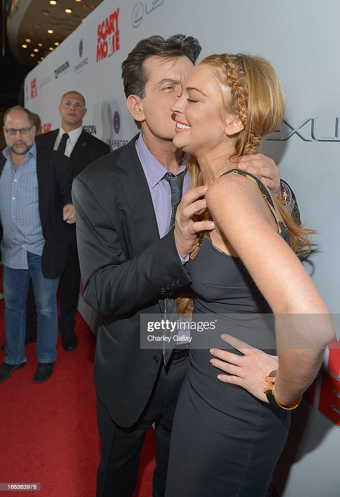 Actors <a gi-track='captionPersonalityLinkClicked' href=/galleries/search?phrase=Charlie+Sheen&family=editorial&specificpeople=206152 ng-click='$event.stopPropagation()'>Charlie Sheen</a> (L) and <a gi-track='captionPersonalityLinkClicked' href=/galleries/search?phrase=Lindsay+Lohan&family=editorial&specificpeople=171623 ng-click='$event.stopPropagation()'>Lindsay Lohan</a> arrive at the premiere of 'Scary Movie V' presented by Dimension Films, in partnership with Lexus and Chambord at the Cinerama Dome on April 11, 2013 in Los Angeles, California.