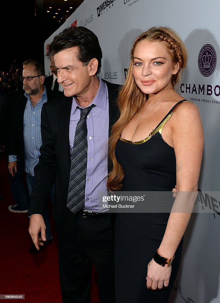 Actors <a gi-track='captionPersonalityLinkClicked' href=/galleries/search?phrase=Charlie+Sheen&family=editorial&specificpeople=206152 ng-click='$event.stopPropagation()'>Charlie Sheen</a> and <a gi-track='captionPersonalityLinkClicked' href=/galleries/search?phrase=Lindsay+Lohan&family=editorial&specificpeople=171623 ng-click='$event.stopPropagation()'>Lindsay Lohan</a> arrive for the premiere of Dimension Films' 'Scary Movie 5' at ArcLight Cinemas Cinerama Dome on April 11, 2013 in Hollywood, California.