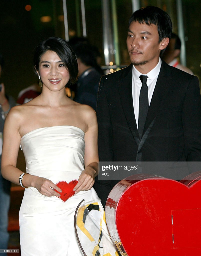 Actors Charlie Yeung and <a gi-track='captionPersonalityLinkClicked' href=/galleries/search?phrase=Chang+Chen+-+Actor&family=editorial&specificpeople=213894 ng-click='$event.stopPropagation()'>Chang Chen</a> attend the Jin Jue Award Awarding Ceremony and 11th Shanghai International Film Festival Closing Ceremony at the Shanghai Grand Theatre on June 22, 2008 in Shanghai, China.