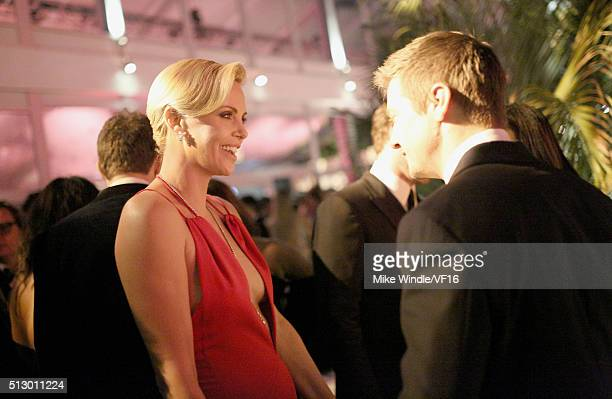 Actors Charlize Theron and Jeremy Renner attend the 2016 Vanity Fair Oscar Party Hosted By Graydon Carter at the Wallis Annenberg Center for the...