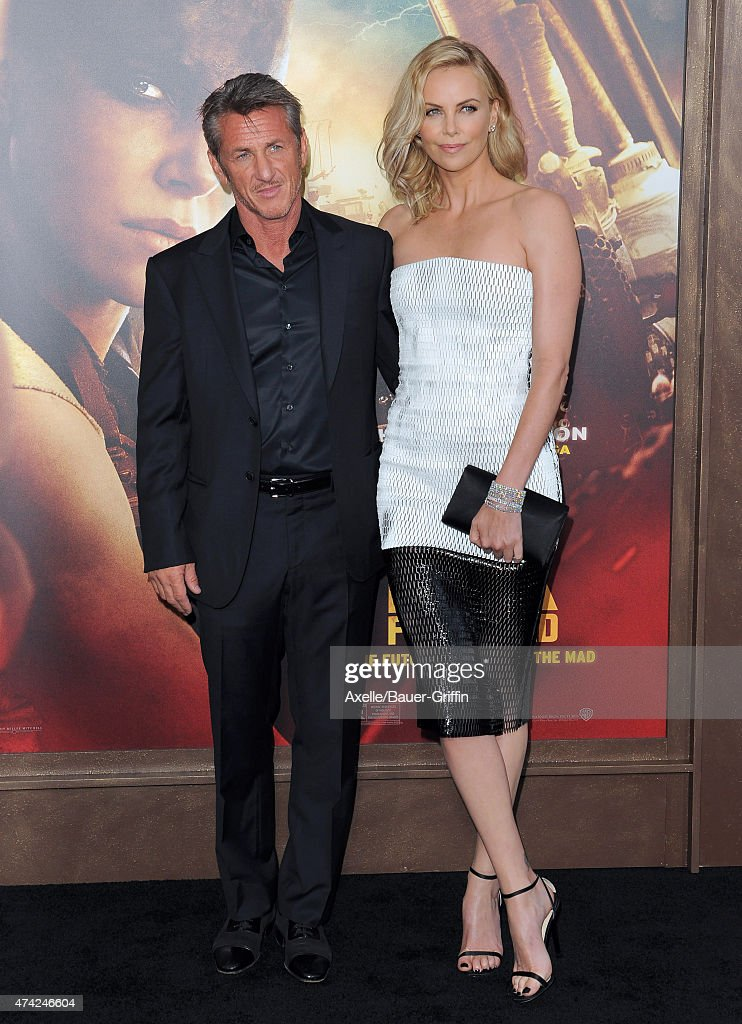 Actors Charlize Theron and Sean Penn arrive at the Los Angeles premiere of 'Mad Max: Fury Road' at TCL Chinese Theatre IMAX on May 7, 2015 in Hollywood, California.