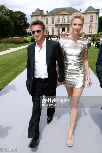 Actors Charlize Theron and Sean Penn attend the Christian Dior show as part of Paris Fashion Week Haute Couture Fall/Winter 20142015 Held at Musee...