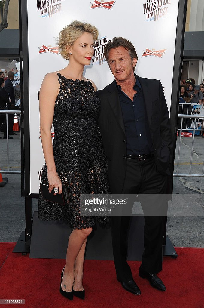 Actors <a gi-track='captionPersonalityLinkClicked' href=/galleries/search?phrase=Charlize+Theron&family=editorial&specificpeople=171250 ng-click='$event.stopPropagation()'>Charlize Theron</a> and <a gi-track='captionPersonalityLinkClicked' href=/galleries/search?phrase=Sean+Penn&family=editorial&specificpeople=202979 ng-click='$event.stopPropagation()'>Sean Penn</a> attend the premiere of 'A Million Ways To Die In The West' presented by Budweiser at Regency Village Theatre on May 15, 2014 in Los Angeles, California.