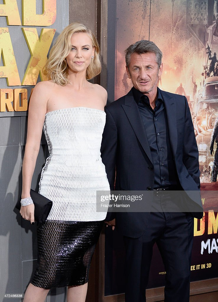 Actors Charlize Theron (L) and Sean Penn attend the premiere of Warner Bros. Pictures' 'Mad Max: Fury Road' at TCL Chinese Theatre on May 7, 2015 in Hollywood, California.