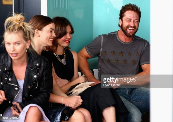 Actors Charlotte Best Emma Lung and Gerard Butler attend the Ellery show during MercedesBenz Fashion Week Australia 2014 at Bondi Icebergs Dining...