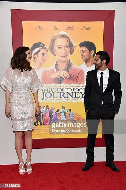 Actors Charlotte Le Bon and Manish Dayal attend the 'The HundredFoot Journey' New York premiere at Ziegfeld Theater on August 4 2014 in New York City