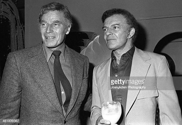 Actors Charlton Heston and Cornel Wilde at a party honoring Heston as the host of a tennis tournament benefiting the American Film Institute on June...