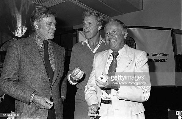 Actors Charlton Heston Wayne Rogers and Dick Van Patten at a party honoring Heston as the host of a tennis tournament benefiting the American Film...