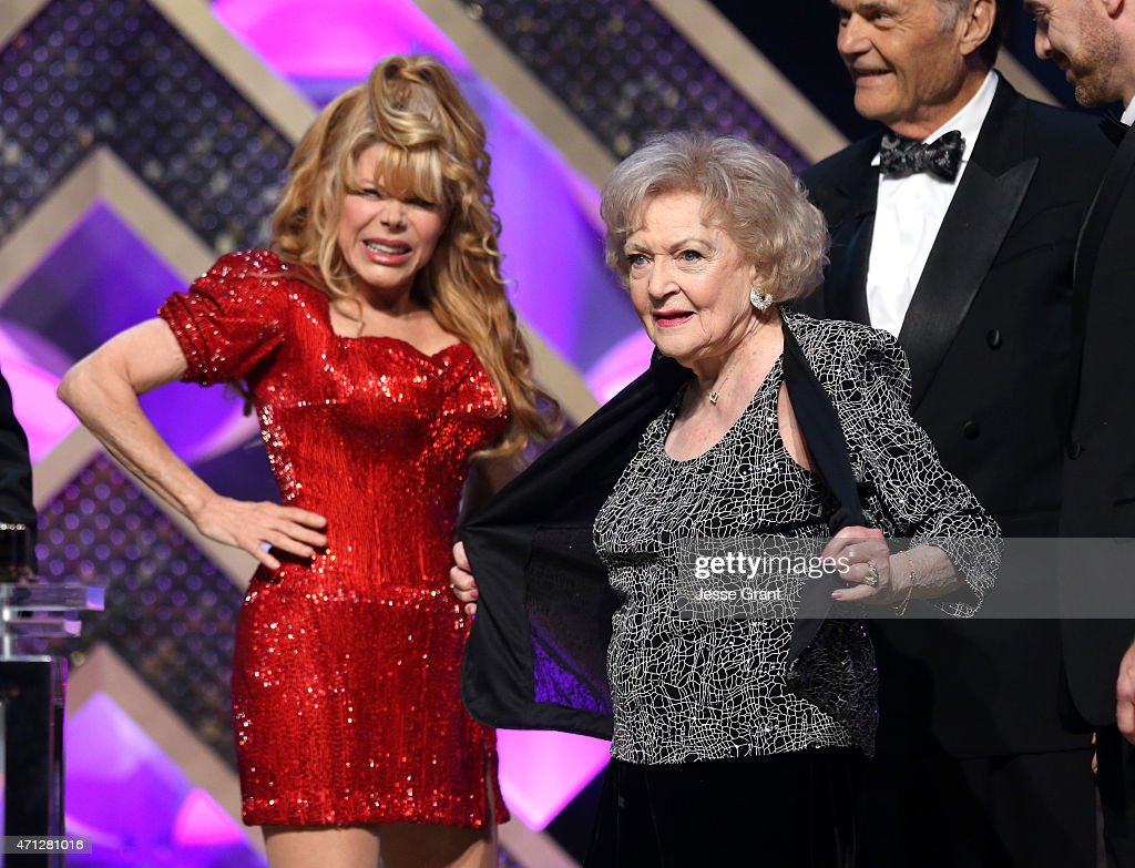Actors Charo and Betty White onstage during The 42nd Annual Daytime Emmy Awards at Warner Bros Studios on April 26 2015 in Burbank California