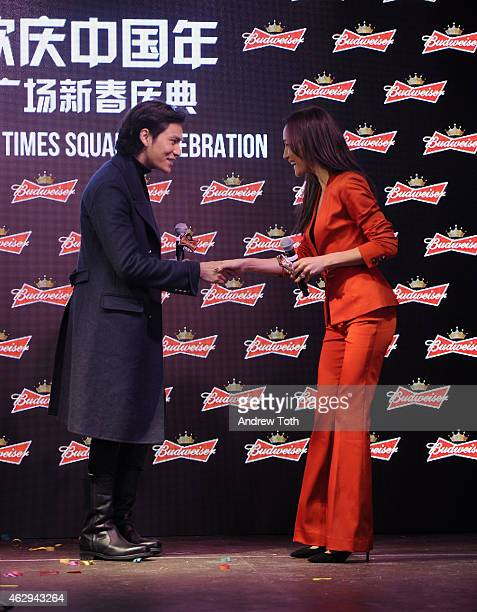 Actors Chen Kun and Maggie Q speak on stage during Maggie Q toasts the Chinese New Year at Times Square on February 7 2015 in New York City