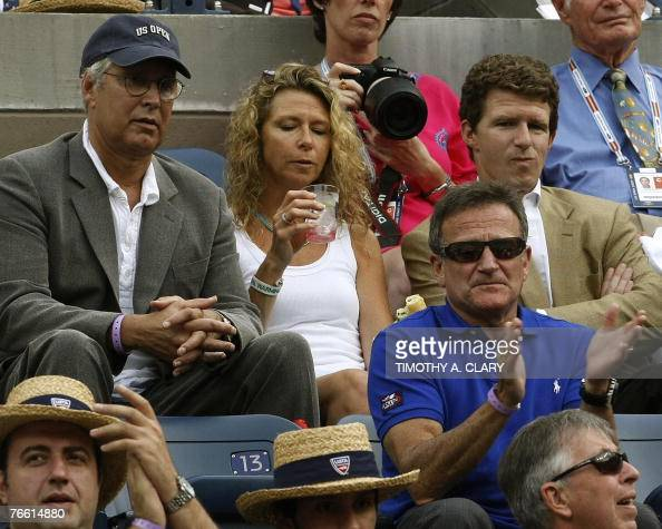 male tennis performer stock photos and pictures getty images us actors chevy chase and robin williams watch the us open men s final between novak djokovic