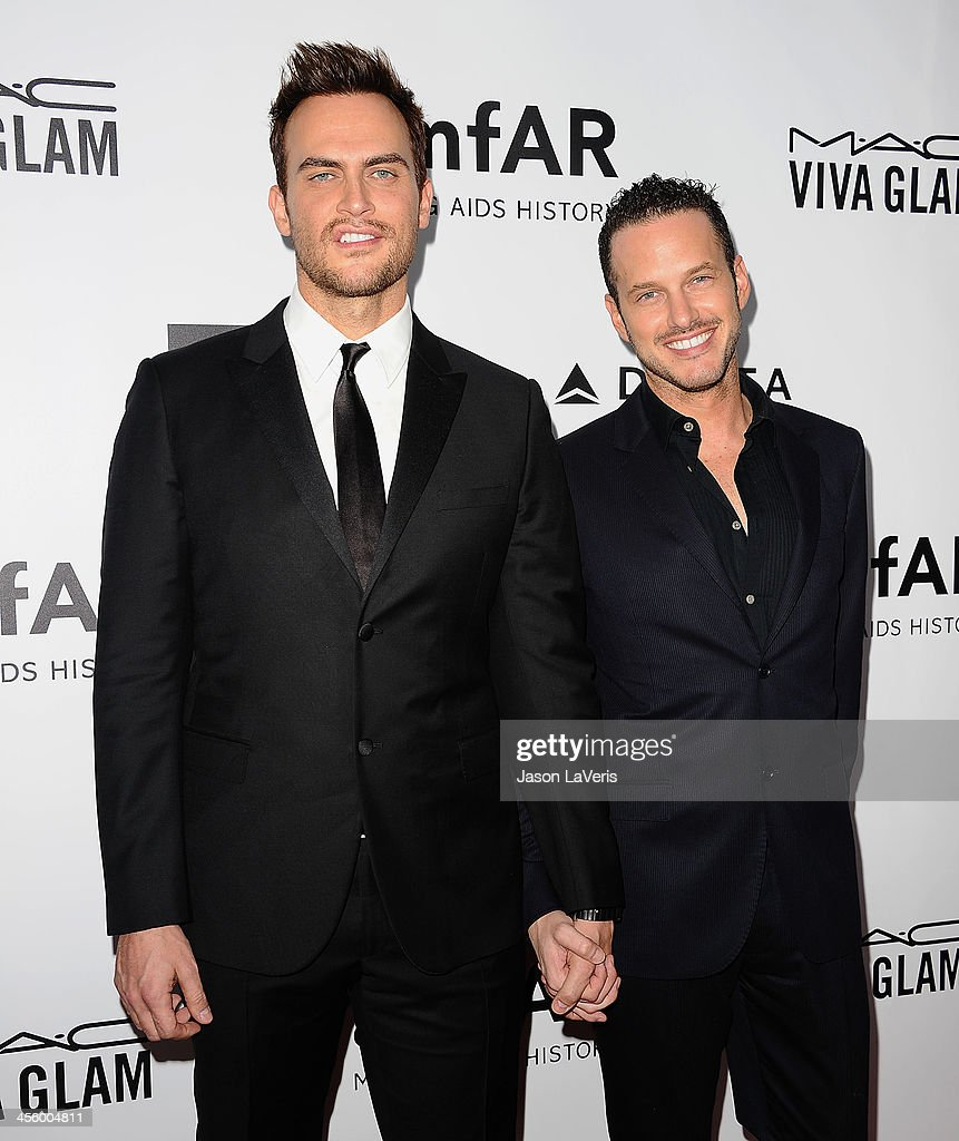 Actors <a gi-track='captionPersonalityLinkClicked' href=/galleries/search?phrase=Cheyenne+Jackson&family=editorial&specificpeople=216481 ng-click='$event.stopPropagation()'>Cheyenne Jackson</a> and Jason Landau attend the amfAR Inspiration Gala at Milk Studios on December 12, 2013 in Hollywood, California.