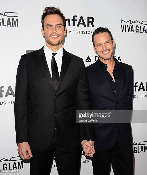 Actors Cheyenne Jackson and Jason Landau attend the amfAR Inspiration Gala at Milk Studios on December 12 2013 in Hollywood California