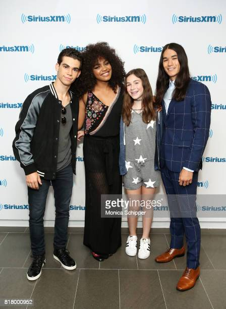 Actors China Anne McClain Cameron Boyce and Booboo Stewart pose for a photo with Skylar Mindich when they visit SiriusXM Studios on July 18 2017 in...
