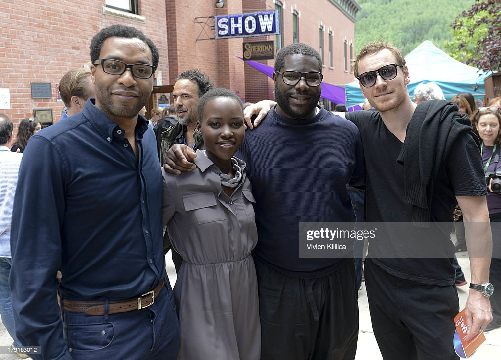 Actors <a gi-track='captionPersonalityLinkClicked' href=/galleries/search?phrase=Chiwetel+Ejiofor&family=editorial&specificpeople=213998 ng-click='$event.stopPropagation()'>Chiwetel Ejiofor</a> and <a gi-track='captionPersonalityLinkClicked' href=/galleries/search?phrase=Lupita+Nyong%27o&family=editorial&specificpeople=10961876 ng-click='$event.stopPropagation()'>Lupita Nyong'o</a>, director Steve McQueen and actor <a gi-track='captionPersonalityLinkClicked' href=/galleries/search?phrase=Michael+Fassbender&family=editorial&specificpeople=4157925 ng-click='$event.stopPropagation()'>Michael Fassbender</a> attend the 2013 Telluride Film Festival - Day 3 on August 31, 2013 in Telluride, Colorado.