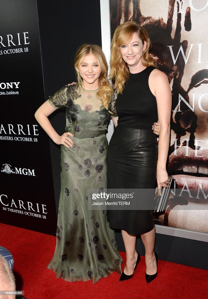 Actors <a gi-track='captionPersonalityLinkClicked' href=/galleries/search?phrase=Chlo%C3%AB+Grace+Moretz&family=editorial&specificpeople=856948 ng-click='$event.stopPropagation()'>Chloë Grace Moretz</a> and <a gi-track='captionPersonalityLinkClicked' href=/galleries/search?phrase=Judy+Greer&family=editorial&specificpeople=214752 ng-click='$event.stopPropagation()'>Judy Greer</a> arrive at the premiere of Metro-Goldwyn-Mayer Pictures & Screen Gems' 'Carrie' at ArcLight Cinemas on October 7, 2013 in Hollywood, California.