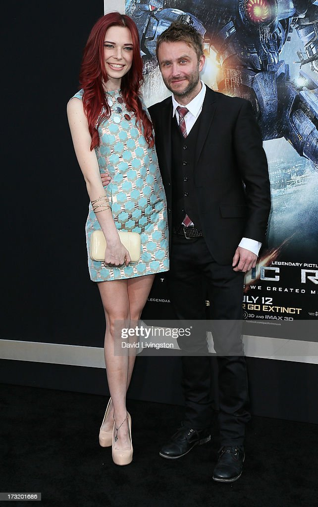 Actors Chloe Dykstra (L) and Chris Hardwick attend the premiere of Warner Bros. Pictures and Legendary Pictures' 'Pacific Rim' at the Dolby Theatre on July 9, 2013 in Hollywood, California.