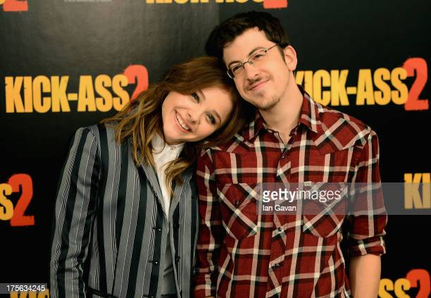 Actors Chloe Grace Moretz and Christopher Mintz Plasse attend the 'KickAss 2' Photocall at Claridges Hotel on August 5 2013 in London England