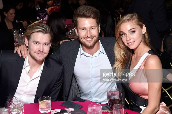 Actors Chord Overstreet and Glen Powell and model Elizabeth Turner attend WCRF's 'An Unforgettable Evening' presented by Saks Fifth Avenue at the...