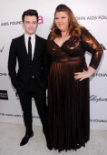 Actors Chris Colfer and Ashley Fink attend the 21st Annual Elton John AIDS Foundation Academy Awards Viewing Party at West Hollywood Park on February...