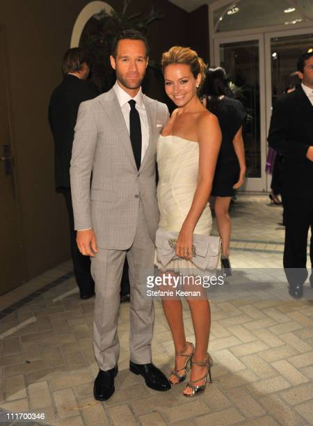 Actors Chris Diamantopoulos and Becki Newton attend the 16th Annual ELLE Women in Hollywood Tribute at the Four Seasons Hotel on October 19 2009 in...