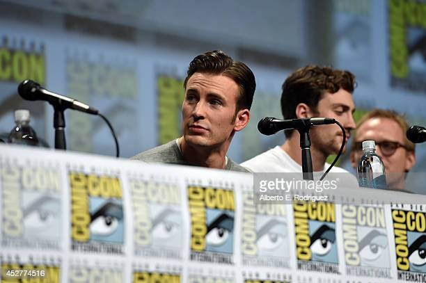 Actors Chris Evans Aaron TaylorJohnson and Paul Bettany onstage at Marvel's Hall H Panel for 'Avengers Age Of Ultron' during ComicCon International...