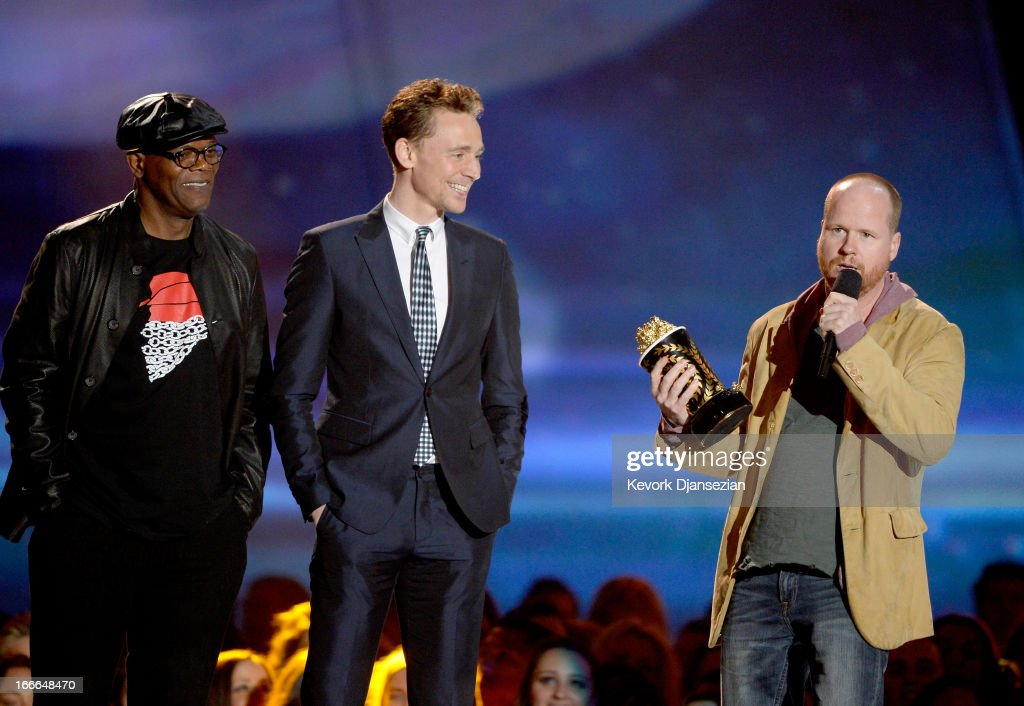 Actors Chris Evans and Samuel L. Jackson and director Joss Whedon accept the Movie of the Year award for 'Marvel's The Avengers' onstage during the 2013 MTV Movie Awards at Sony Pictures Studios on April 14, 2013 in Culver City, California.