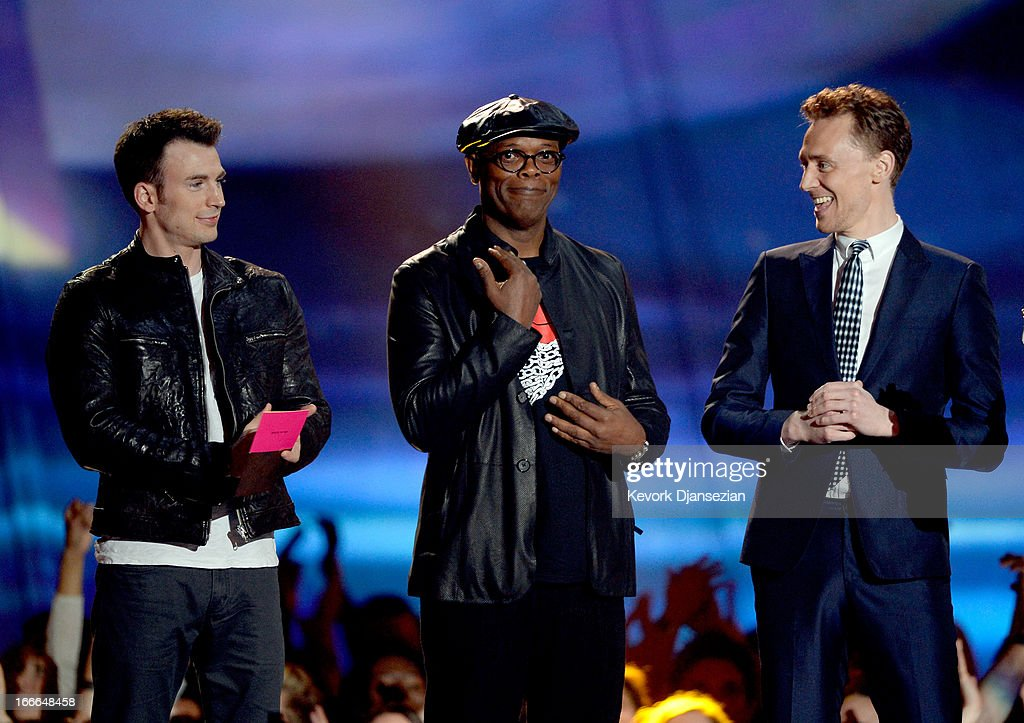 Actors Chris Evans, Samuel L. Jackson and Tom Hiddleston accept the Movie of the Year award for 'Marvel's The Avengers' onstage during the 2013 MTV Movie Awards at Sony Pictures Studios on April 14, 2013 in Culver City, California.