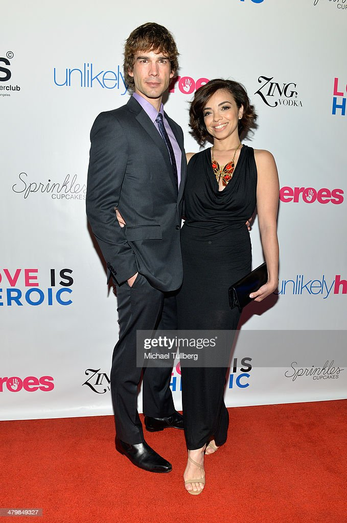 Actors Chris Gorham and Anel Lopez-Gorham attend the Unlikely Heroes Red Carpet Spring Benefit held at SupperClub Los Angeles on March 20, 2014 in Los Angeles, California.