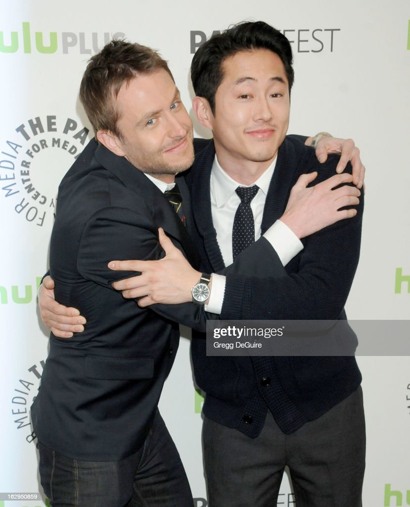 Actors <a gi-track='captionPersonalityLinkClicked' href=/galleries/search?phrase=Chris+Hardwick&family=editorial&specificpeople=960855 ng-click='$event.stopPropagation()'>Chris Hardwick</a> and Steven Yeun arrive at the 30th Annual PaleyFest: The William S. Paley Television Festival featuring 'The Walking Dead' at Saban Theatre on March 1, 2013 in Beverly Hills, California.