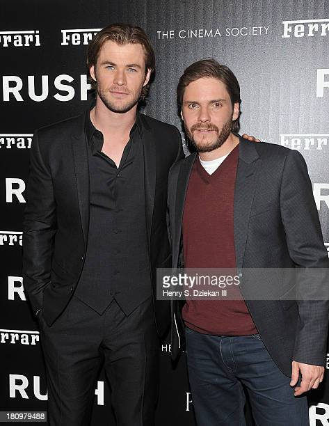 Actors Chris Hemsworth and Daniel Bruhl attend the Ferrari The Cinema Society screening of 'Rush' at Chelsea Clearview Cinema on September 18 2013 in...
